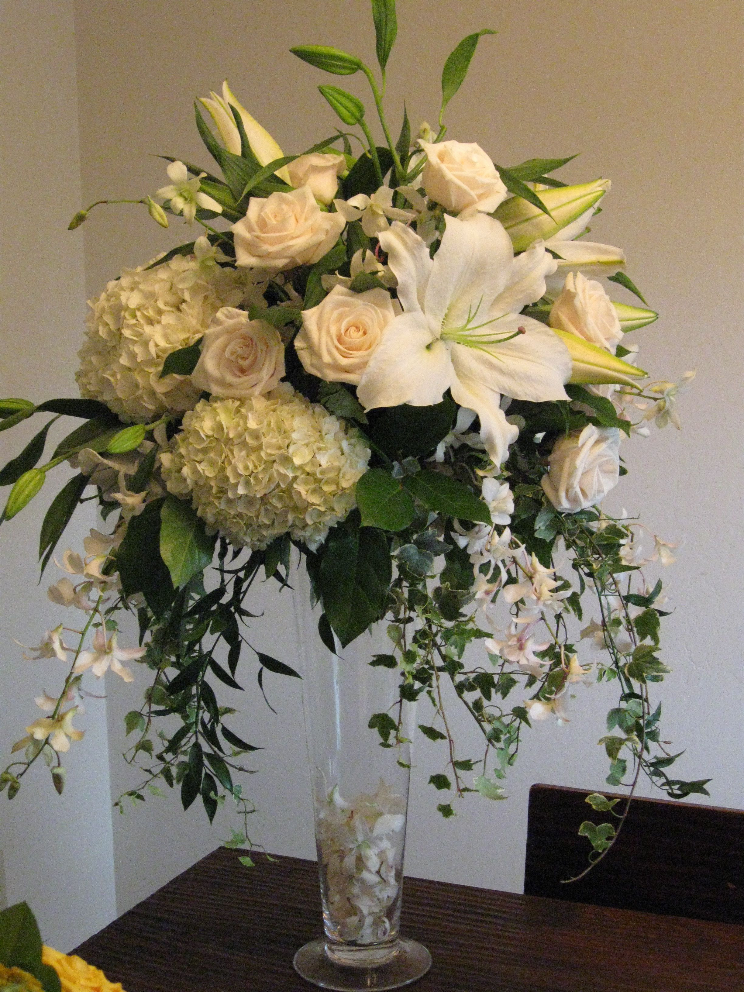 arranging flowers in a round vase of centerpiece white roses hydrangea orchids tall vendela the for centerpiece white roses hydrangea orchids tall vendela the blue orchid dendrobium ivy casa