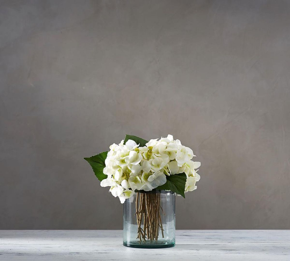 Artificial Hydrangeas In Vase Of Faux White Hydrangea Arrangement In Glass Vase Family Room In White Hydrangea Arrangement In Glass Vase