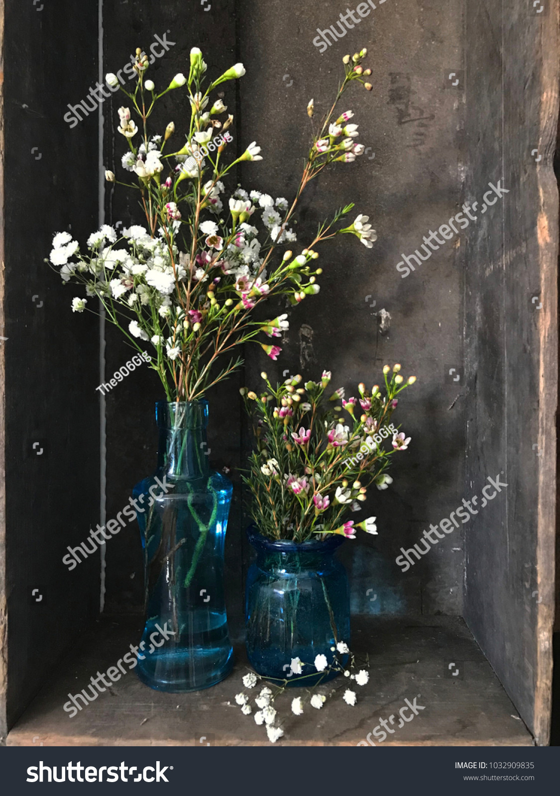 Blown Glass Vase On Wood Of Wildflowers Babys Breath Blue Glass Vases Stock Photo Edit now with Wildflowers and Babys Breath In Blue Glass Vases Wood Background Rustic Country Scene