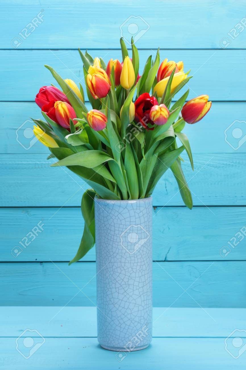 Blue Green Glass Vase Of Light Blue Glass Vase Pictures Bunch Od Red and Yellow Tulips with Intended for Light Blue Glass Vase Pictures Bunch Od Red and Yellow Tulips with Blue Background Stock Of