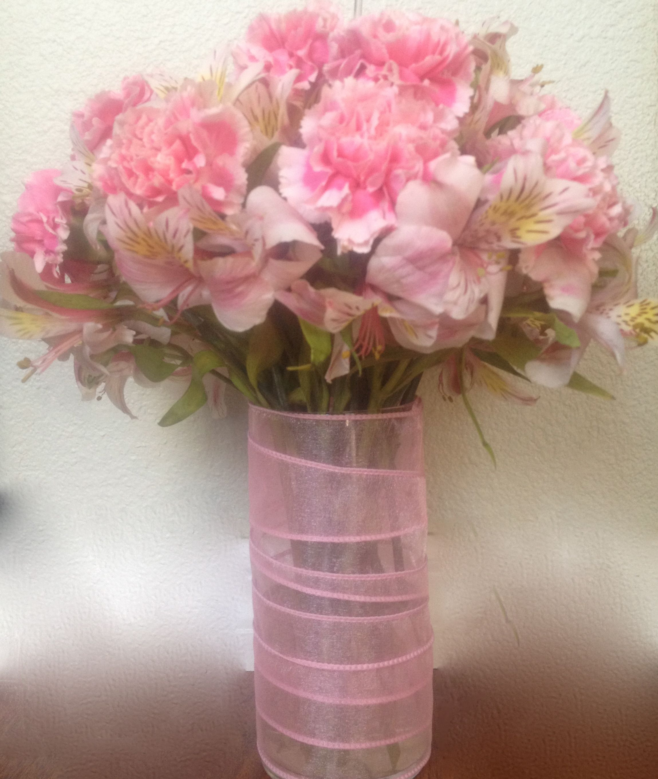 carnation arrangements in vase of its a girl pink carnations alstroemeria in a glass vase wrapped with pink carnations alstroemeria in a glass vase wrapped in pink ribbon