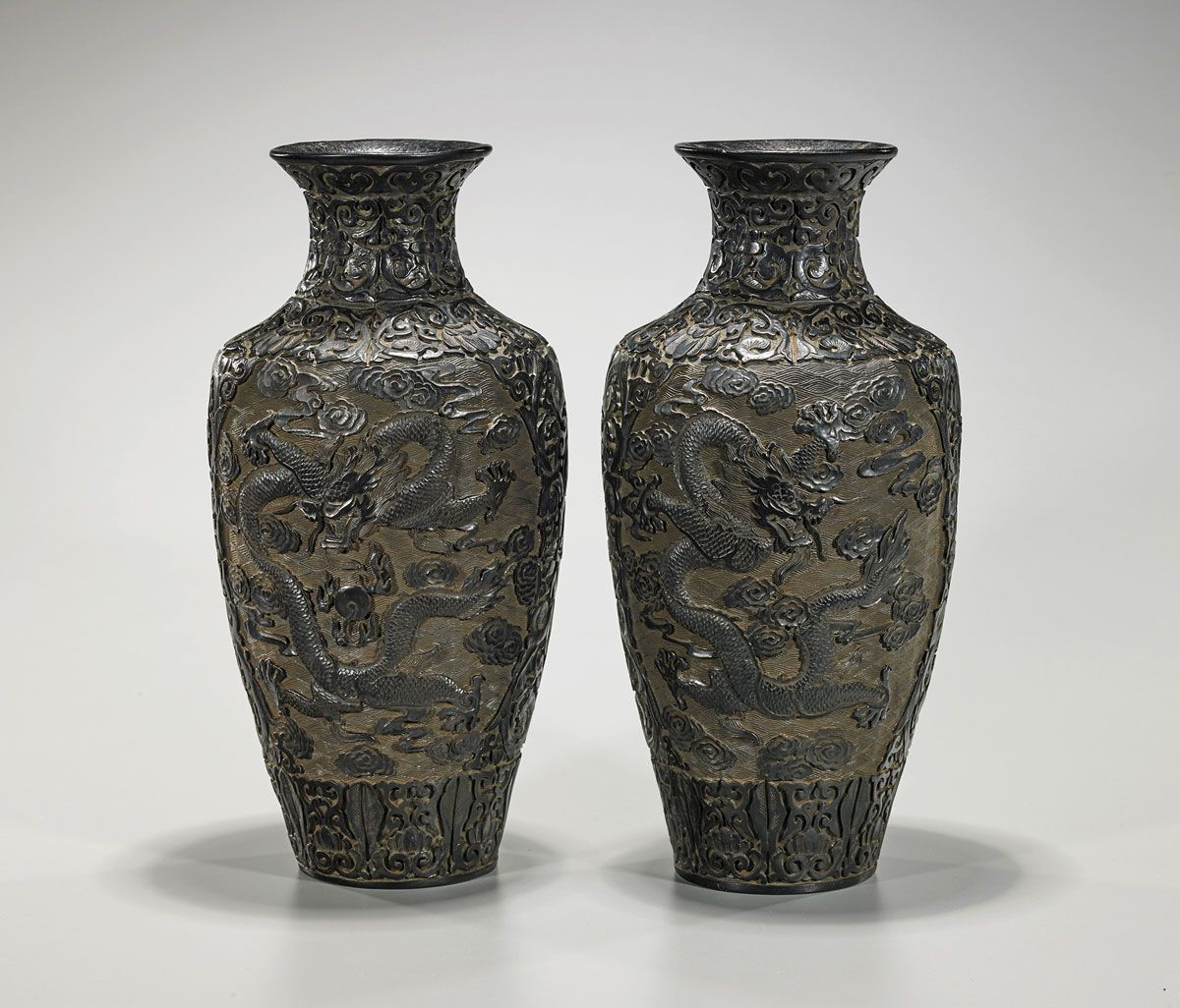 Chinese Lacquer Vase Of Pair Of Chinese Lacquer Like Vases Each Of Ovoid form with Flaring Inside Pair Of Chinese Lacquer Like Vases Each Of Ovoid form with Flaring Rim Showing Design Of Celestial Dragons and Scrolling Flora In Relief Qianlong Mark to