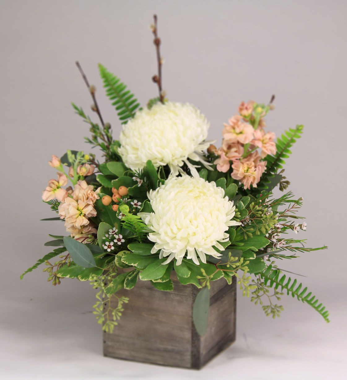 clear cube vase of footballs and stock a wooden cube vase with ivory football mums regarding footballs and stock a wooden cube vase with ivory football mums peach stock and