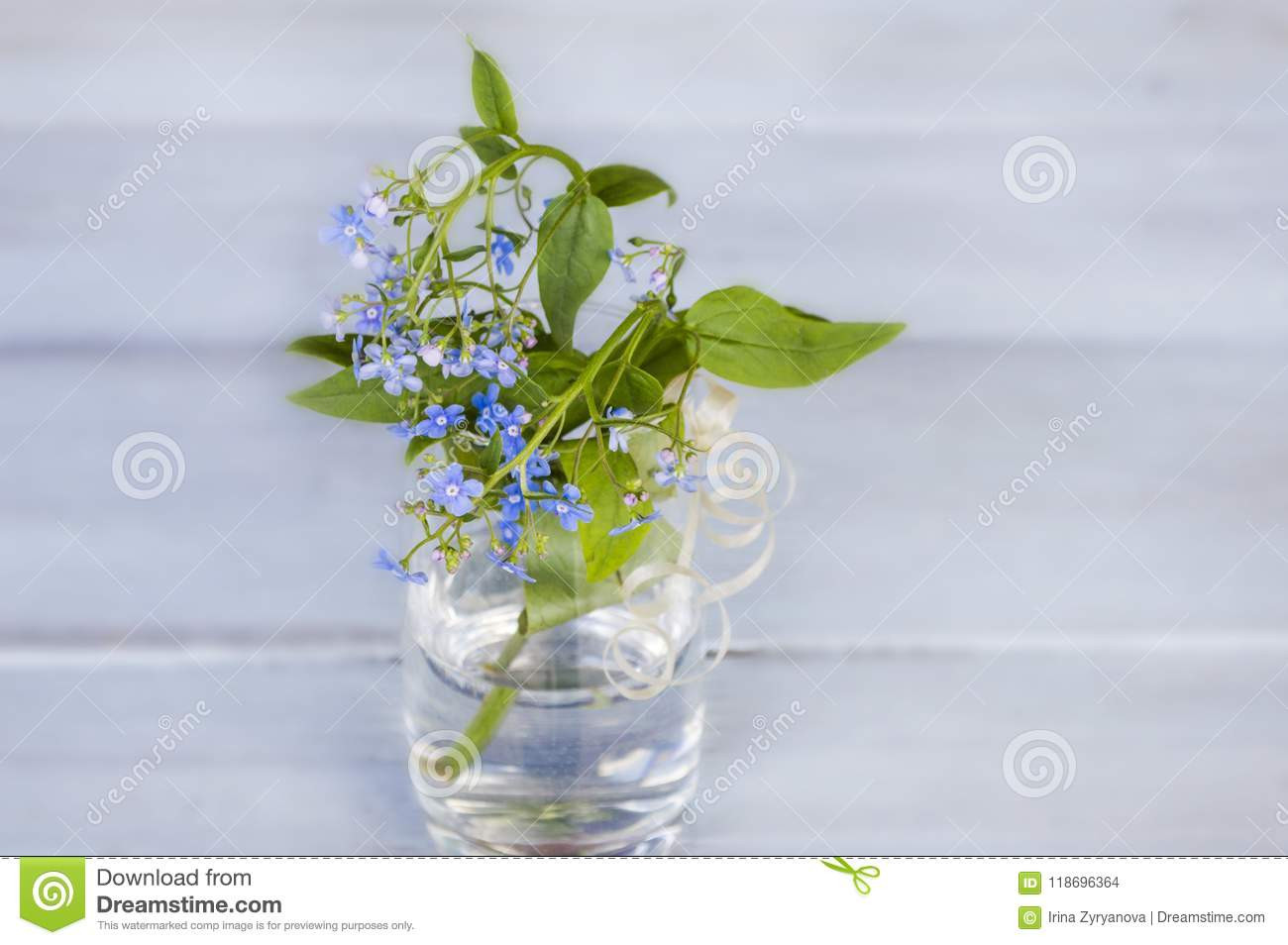 colored glass vases cheap of blue forget me nots in a transparent vase on a wooden background throughout blue forget me nots in a transparent vase on a wooden background