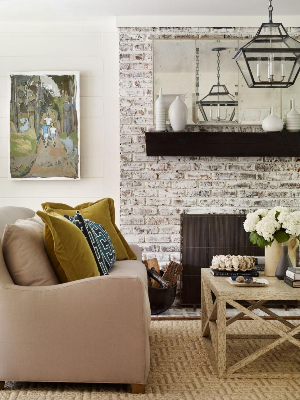 dark wood vase of this living room features a whitewashed fireplace with a dark wood with thislivingroomfeaturesawhitewashedfireplacewith