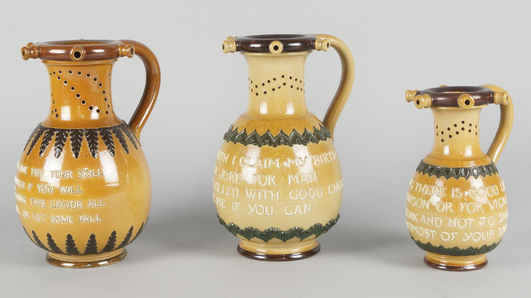doulton lambeth vase of three doulton lambeth stoneware puzzle jugs each with a different for lot 95 three doulton lambeth stoneware puzzle jugs each with a different motto in