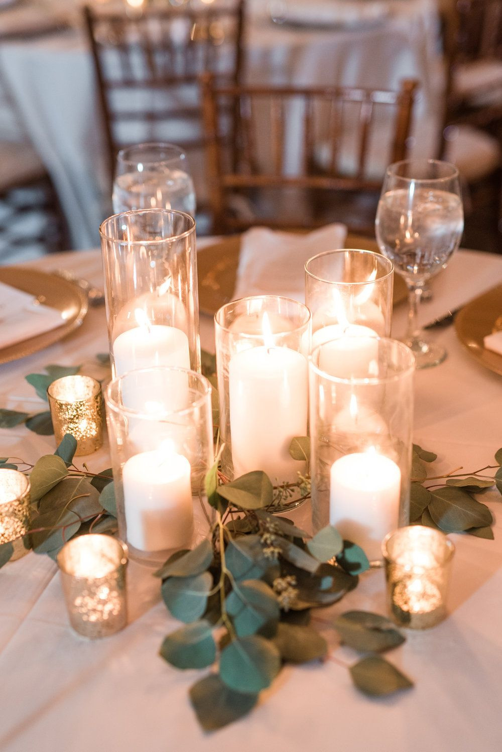 floating candle cylinder vase sets of jessica johns early mountain vineyard wedding floral regarding romantic candlelit pillar candle centerpiece with eucalyptus greenery and gold mercury glass votives for a winery