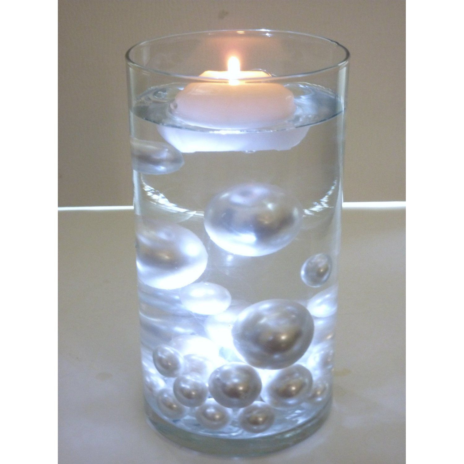 floating vase fillers of clear gel that makes it look like the pearls are floating im sure throughout clear gel that makes it look like the pearls are floating im sure we can figure something out along these lines