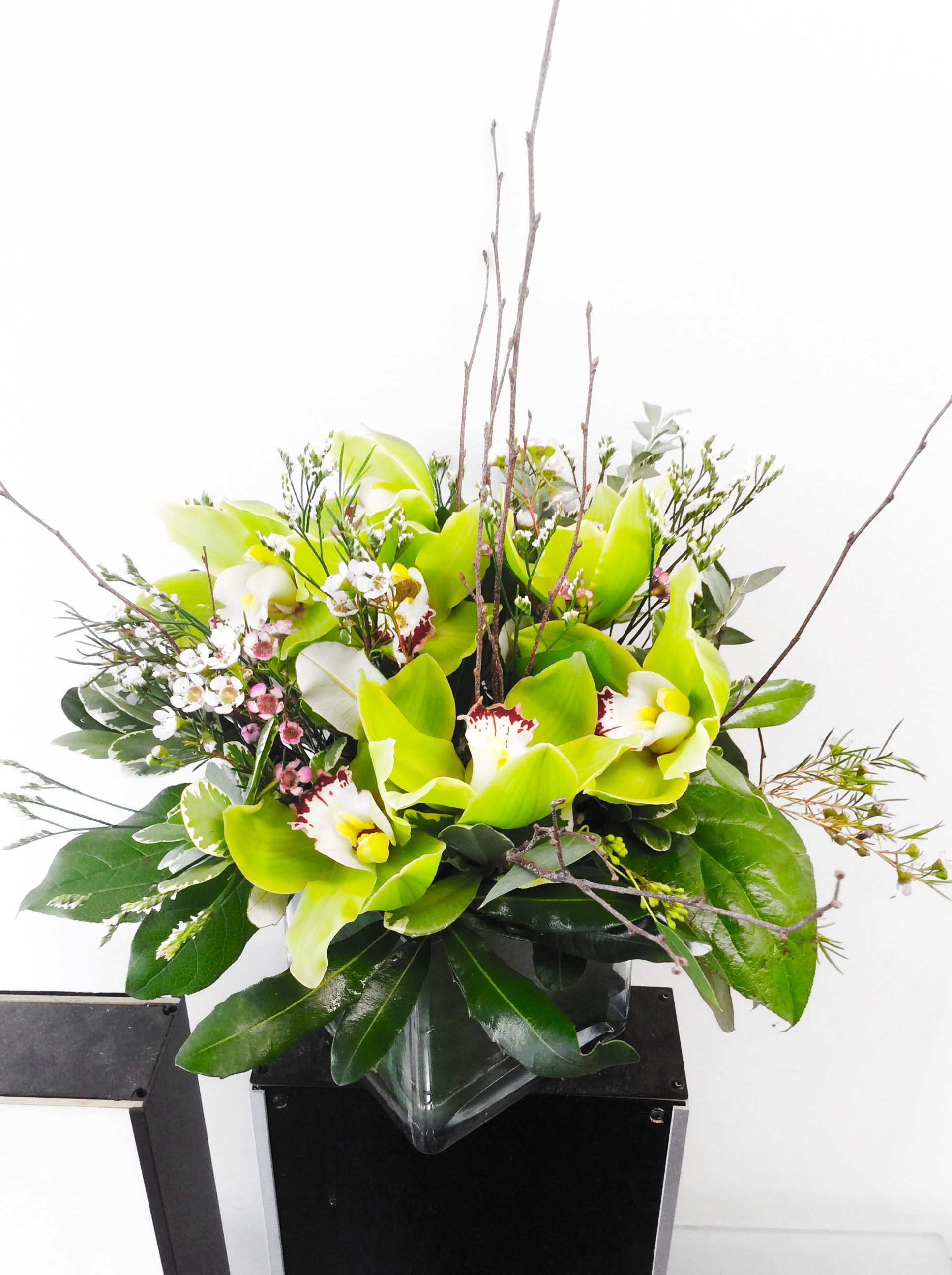 flowers delivered in vase of a custom floral arrangement in a square vase designed by flowers within a custom floral arrangement in a square vase designed by flowers naturally in