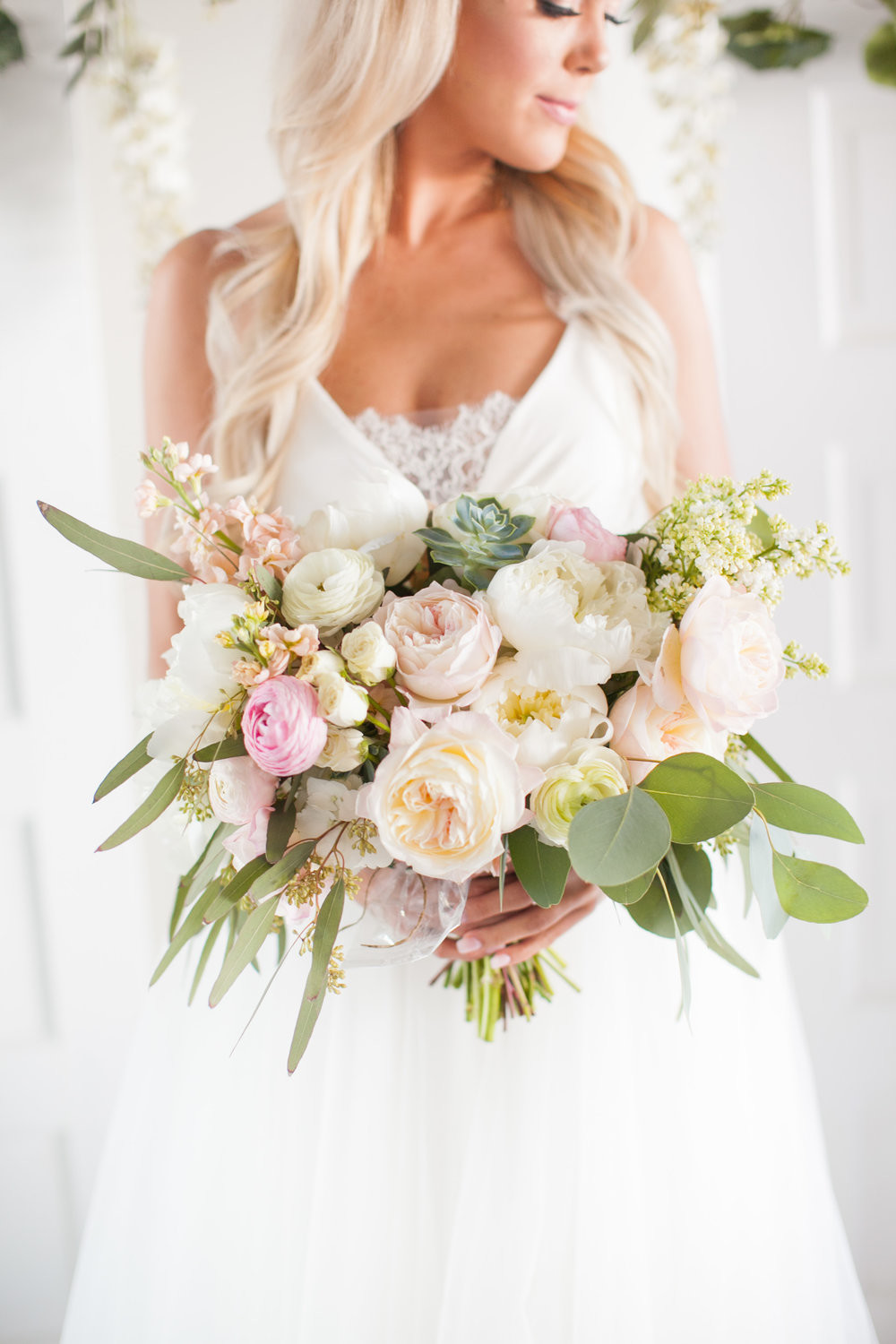 ftd cross vase of lace and lilies in cristy cross photography