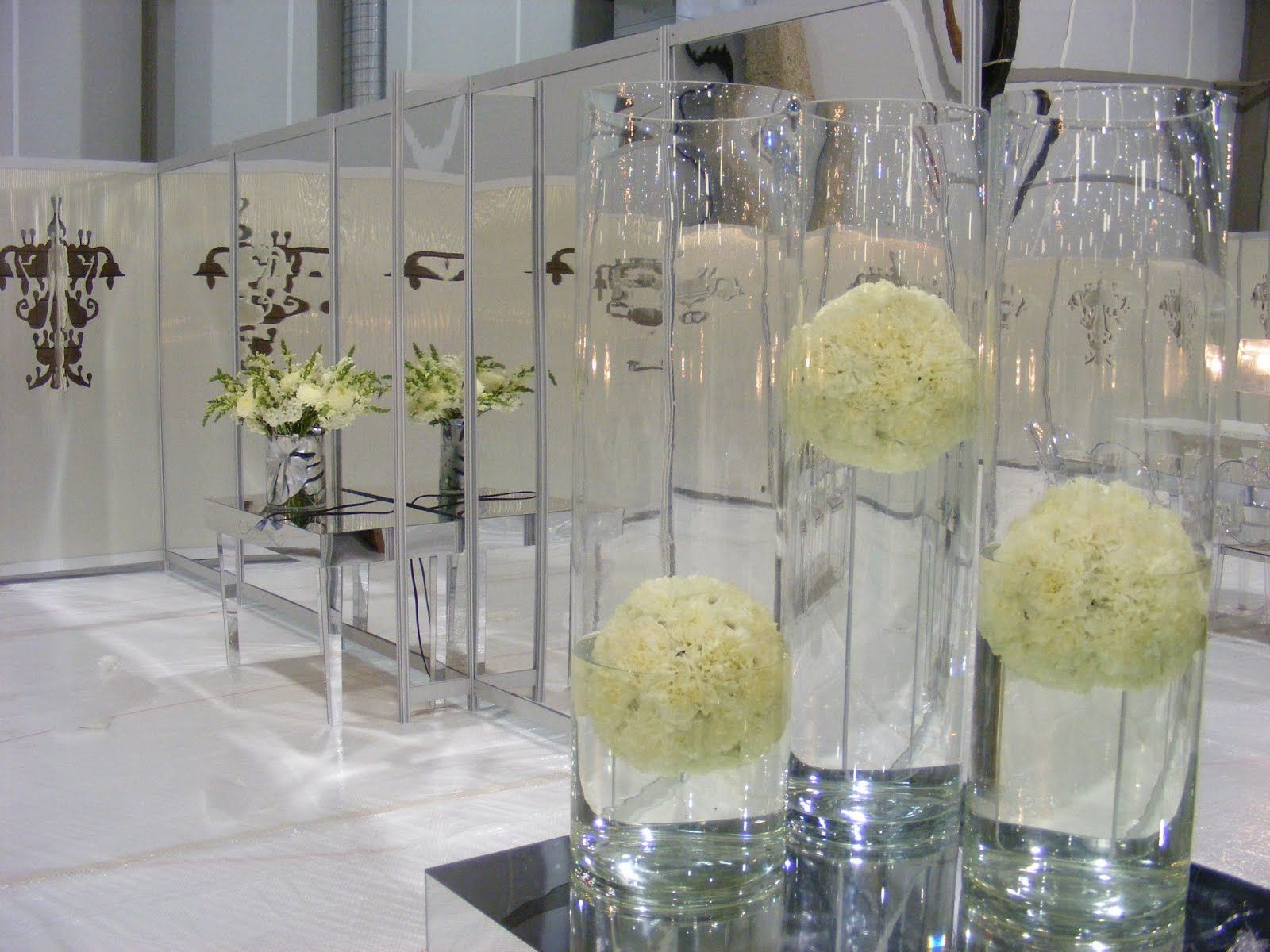 glass cylinder vases for centerpieces of we featured a trio of floating white flower balls in large glass intended for we featured a trio of floating white flower balls in large glass cylind
