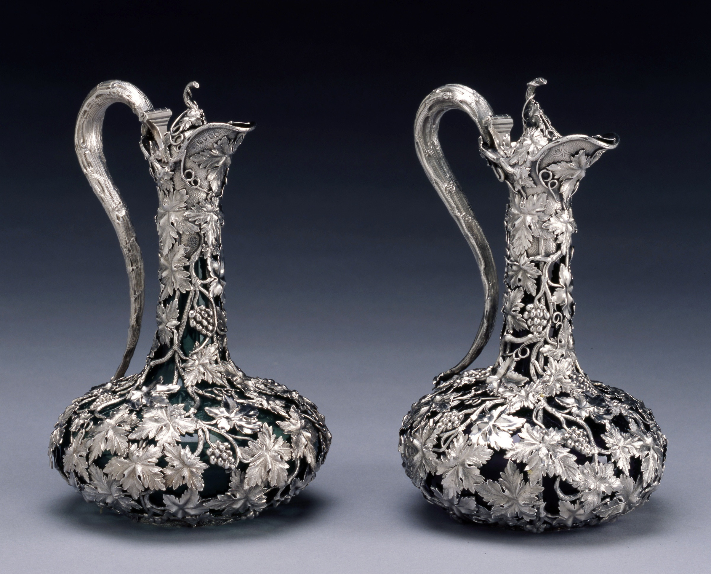 glass vase with handle of charles reily george storer a pair of victorian claret jugs by with a pair of victorian claret jugs by charles reily george storer