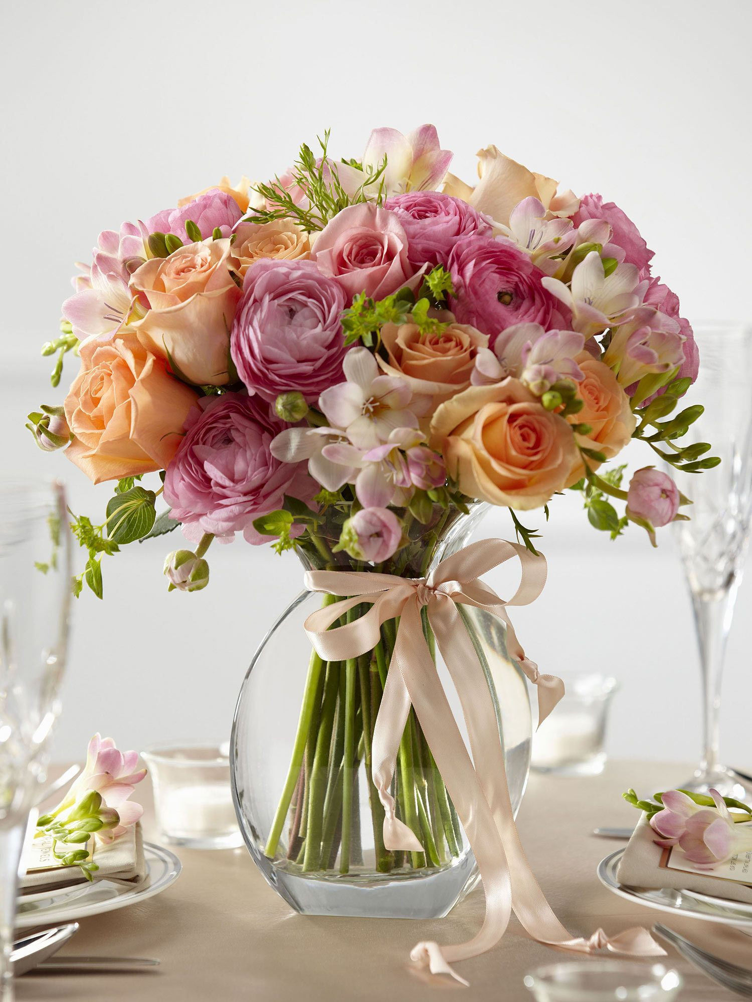 glass vases for flower arrangements of the stunning arrangement in soft shades of pink and orange creates a pertaining to the stunning arrangement in soft shades of pink and orange creates a sweet centerpiece to accent your tables on your wedding day peach roses pink freesia