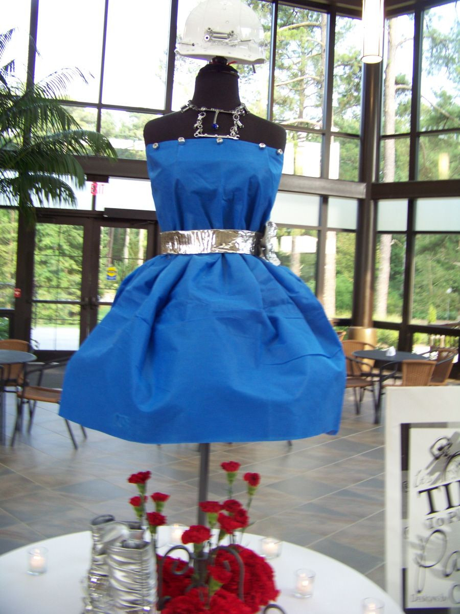 hobby lobby pilsner vase of an interesting centerpiece for the hard hats and high heels theme for an interesting centerpiece for the hard hats and high heels theme the dress was made of a tarp the belt insulation material the jewelry all out of bolts