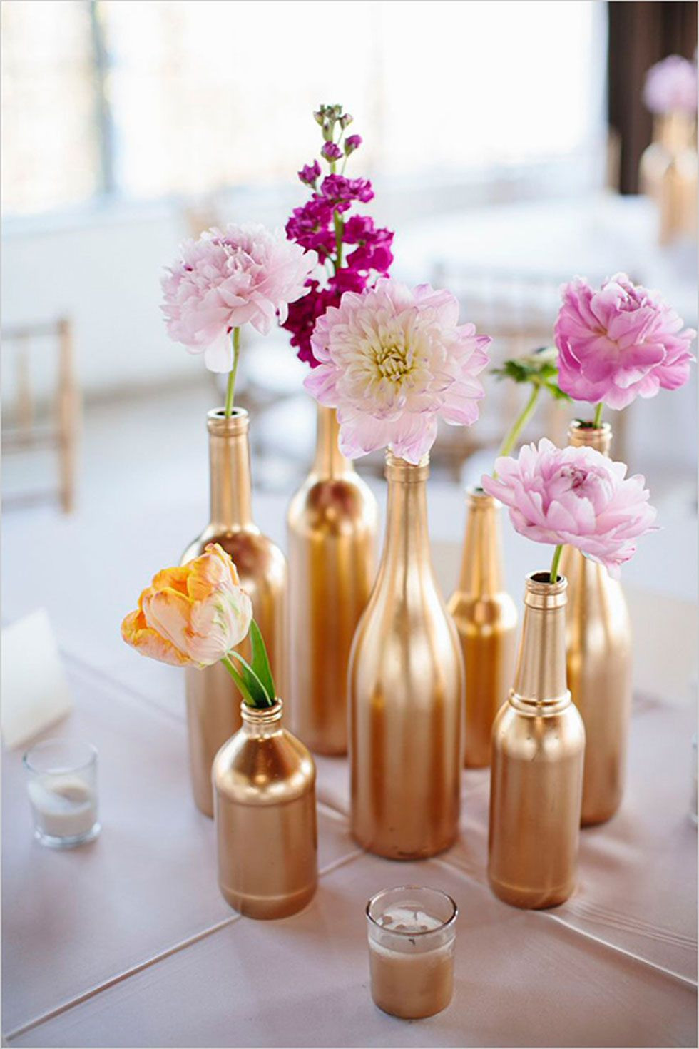 ideas for glass vases for centerpieces of 55 creative bridal shower ideas that are as special as the bride to with these spray painted glass bottles look gorgeous as simple vases for individ