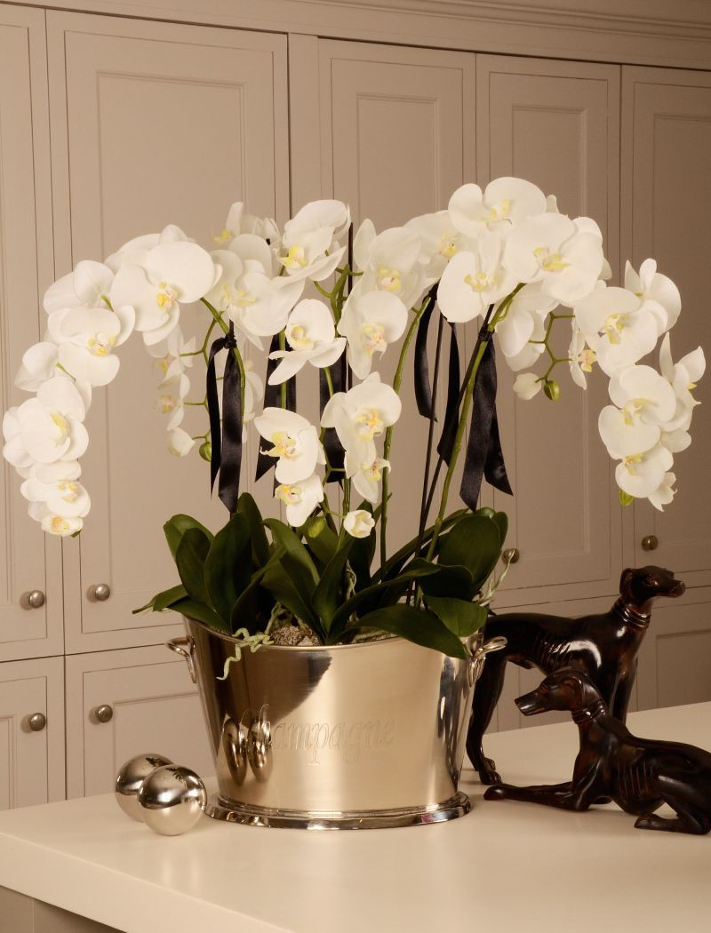 large artificial flowers in vase of orchid in a large champagne cooler rtfact artificial silk with orchid in a large champagne cooler rtfact artificial silk flowers