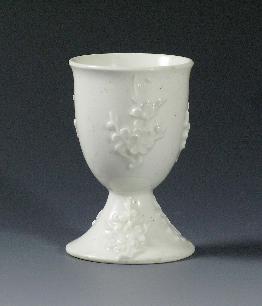 large asian vase of white porcelain collection intended for formed as a tall bowl on a spreading conical foot both decorated with applied prunus sprigs