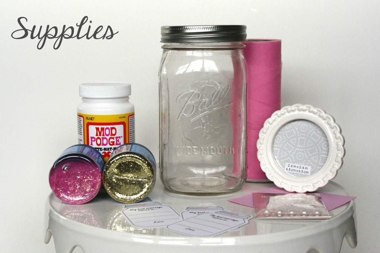 modge podge pictures on glass vase of glitter mason jar and marriage advice cards in supplies
