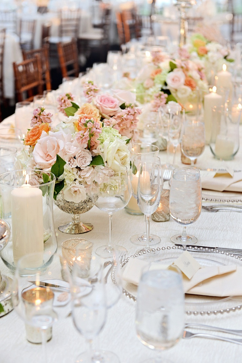 native american wedding vase tradition of a gorgeous lakefront ceremony tented reception with peach details with white wedding table with silver accents and pink flowers