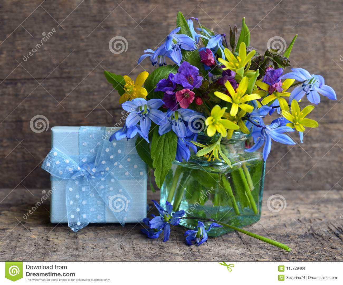 old blue glass vases of bright spring flowers bouquet in a glass vase and gift box on old with regard to bright spring flowers bouquet in a glass vase and gift box on old wooden background