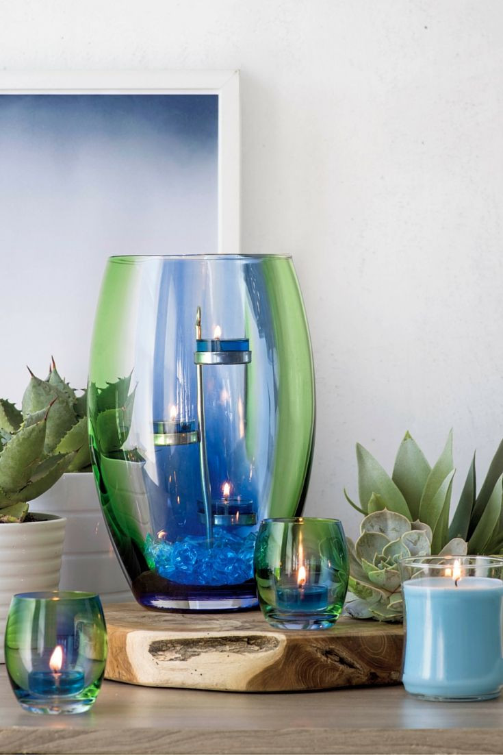 partylite hurricane vase of artisan blown glass hurricane is awash in the vibrant shades of with artisan blown glass hurricane is awash in the vibrant shades of spring the vivid green of fresh grass the bright blue of the morning sky