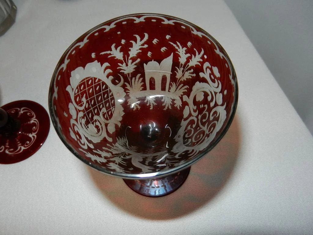 ruby cut glass vase of vintage bohemian pigeon blood decanter and ruby cut to clear glasses inside click to expand