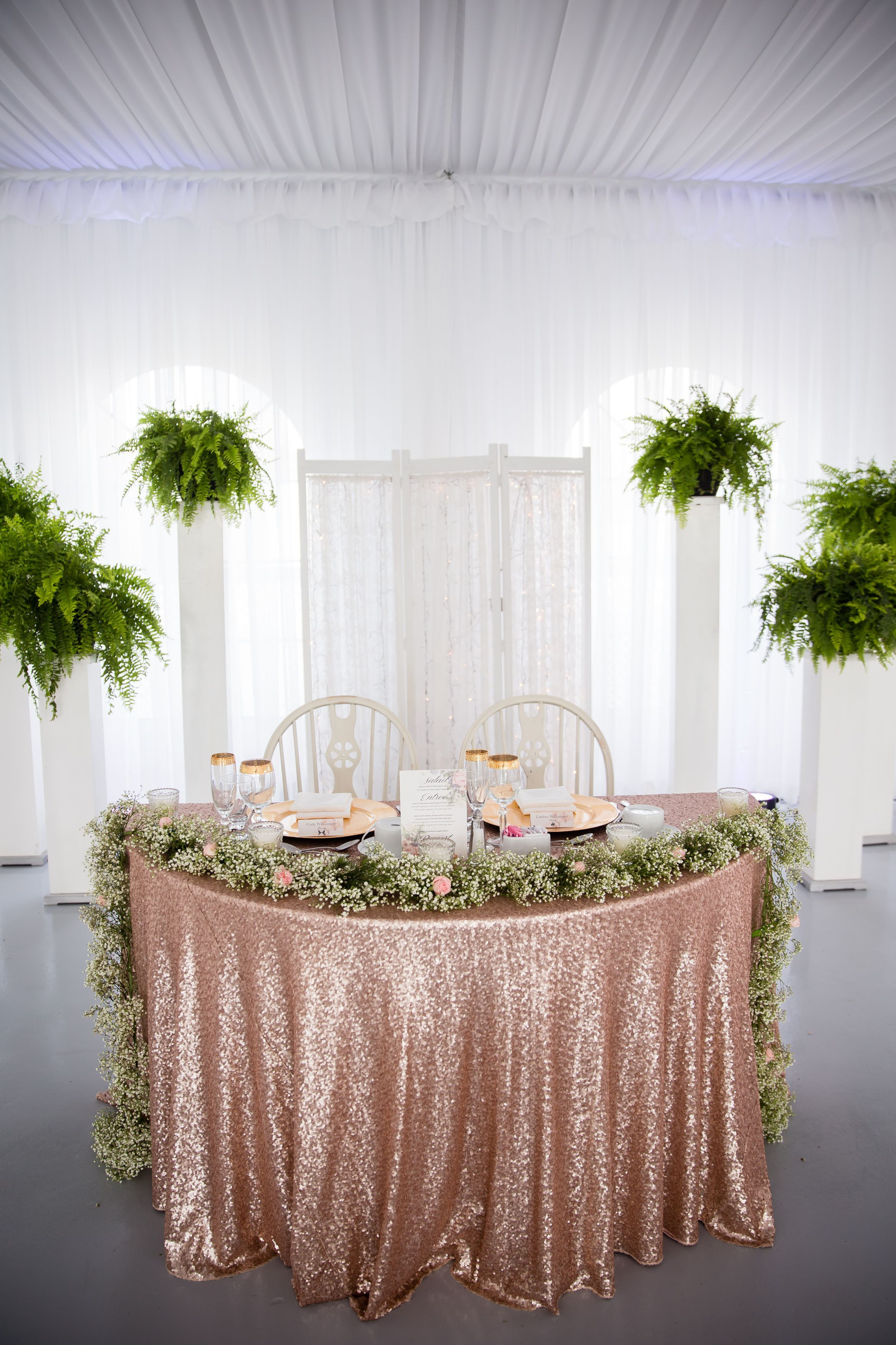 small rose gold vase of our sweetheart table rose gold glitter table cloth with babys for rose gold glitter table cloth with babys breath and tiny pink roses we opted for a simple lace back drop behind us