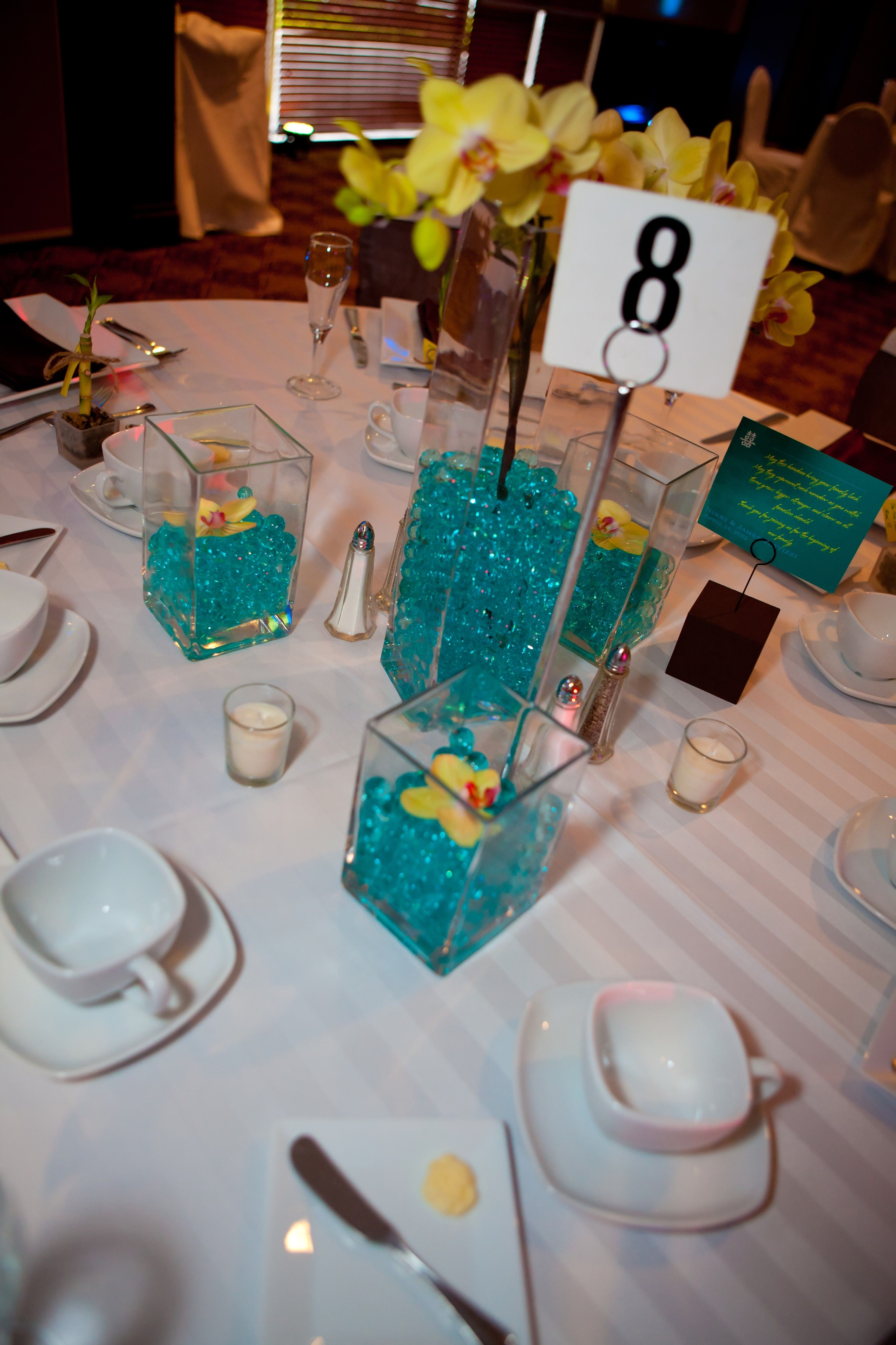 small square vases for wedding of wedding centerpieces square vases teal water beads yellow inside wedding centerpieces square vases teal water beads yellow orchids candles