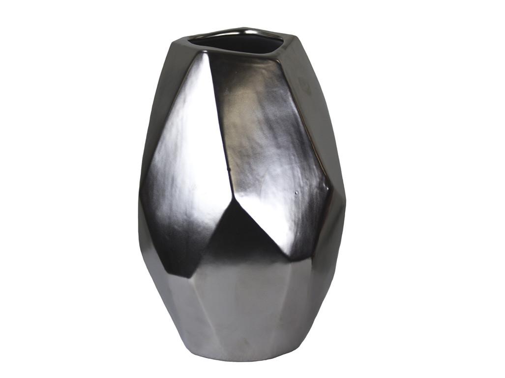 square vase floral arrangement of wood and mirror vase inside silver ceramic geo vase