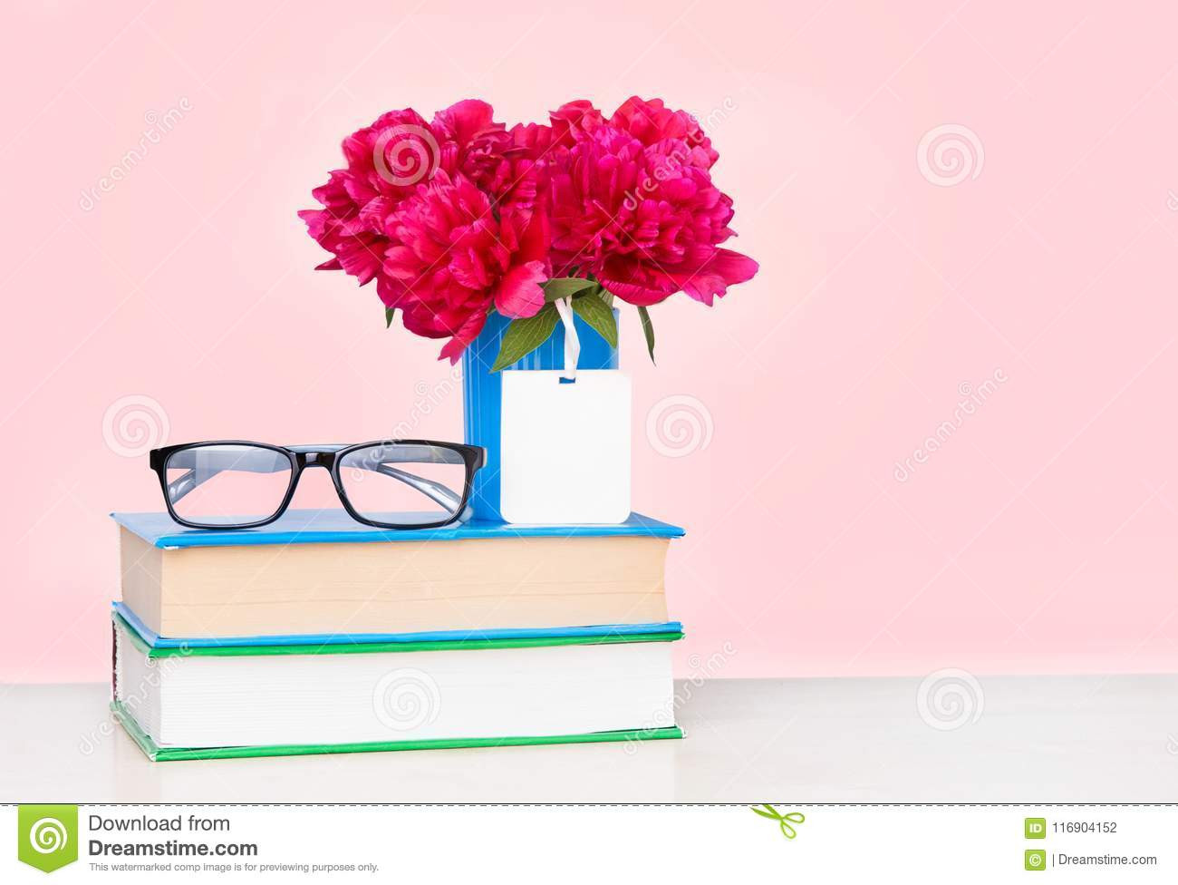 stacked teacup vase of a pile of books and a vase of flowers on a wooden table stock photo regarding a pile of books and a vase of flowers on a wooden table