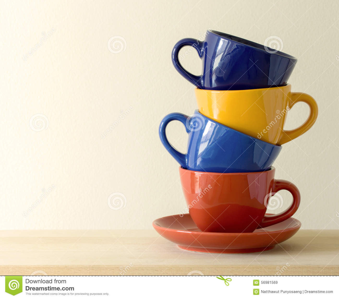 stacked teacup vase of stack of mugs castrophotos intended for stack of colorful coffee cups on table stock photo image