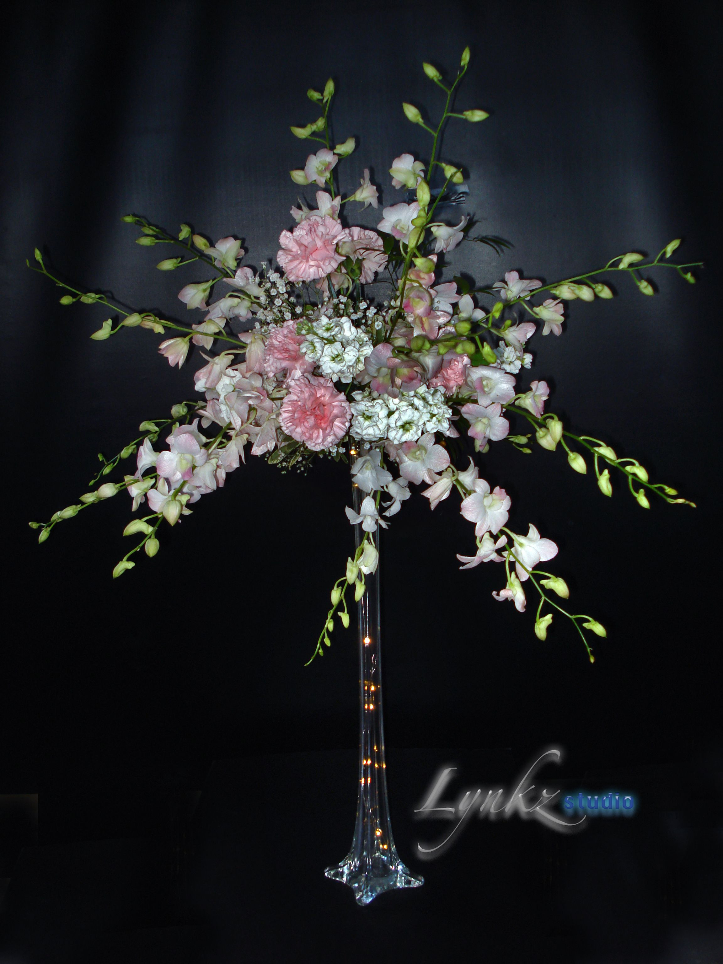 tall clear flower vases wedding of beautiful pink dendrobium orchids on clear eiffel vase as guest in beautiful pink dendrobium orchids on clear eiffel vase as guest table centerpiece