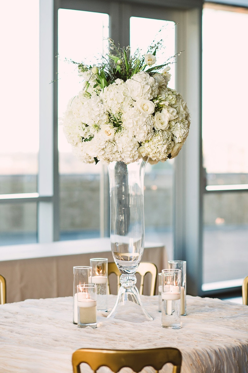 tall glass wedding vases of reception dacor photos large floral arrangement atop glass vase in large ivory arrangement with hydrangeas roses greenery