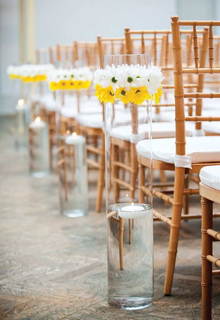 tall gold centerpiece vases of wedding flowers symbolic meanings of flowers for white and yellow daisy aisle decor
