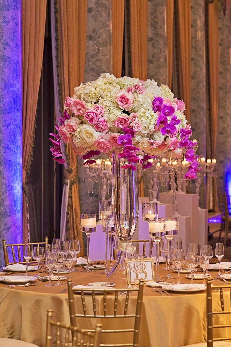 tall skinny gold vases of new york yankees infielder marries in opulent chicago soirae with white hydrangeas pink roses purple orchids wedding centerpiece gold linens