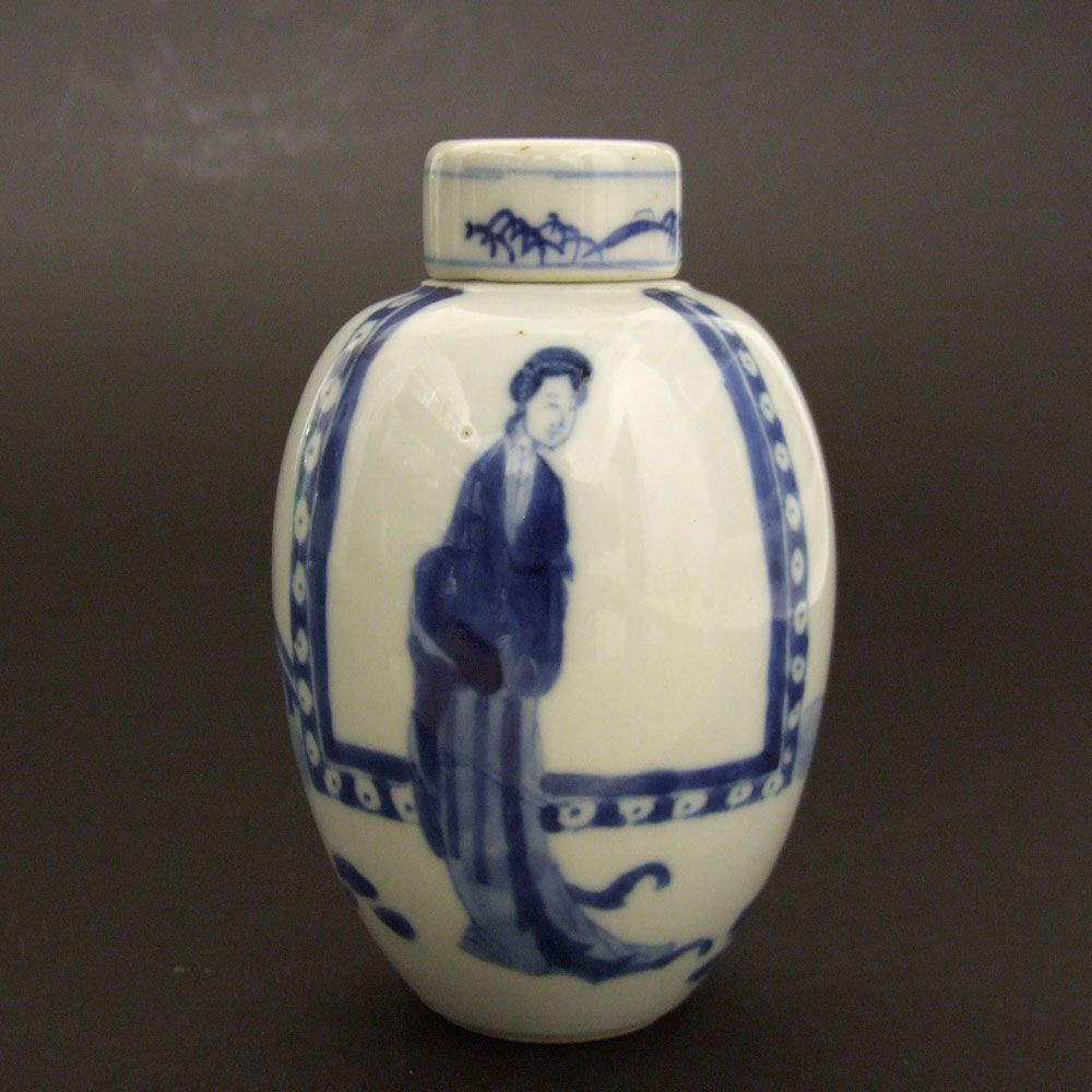tall thin blue vase of a kangxi blue and white porcelain jar and cover c 1690 1710 inside a kangxi blue and white porcelain jar and cover c 1690 1710 decorated with long eliza lange lyzen within a garden landscape the cover painted with a