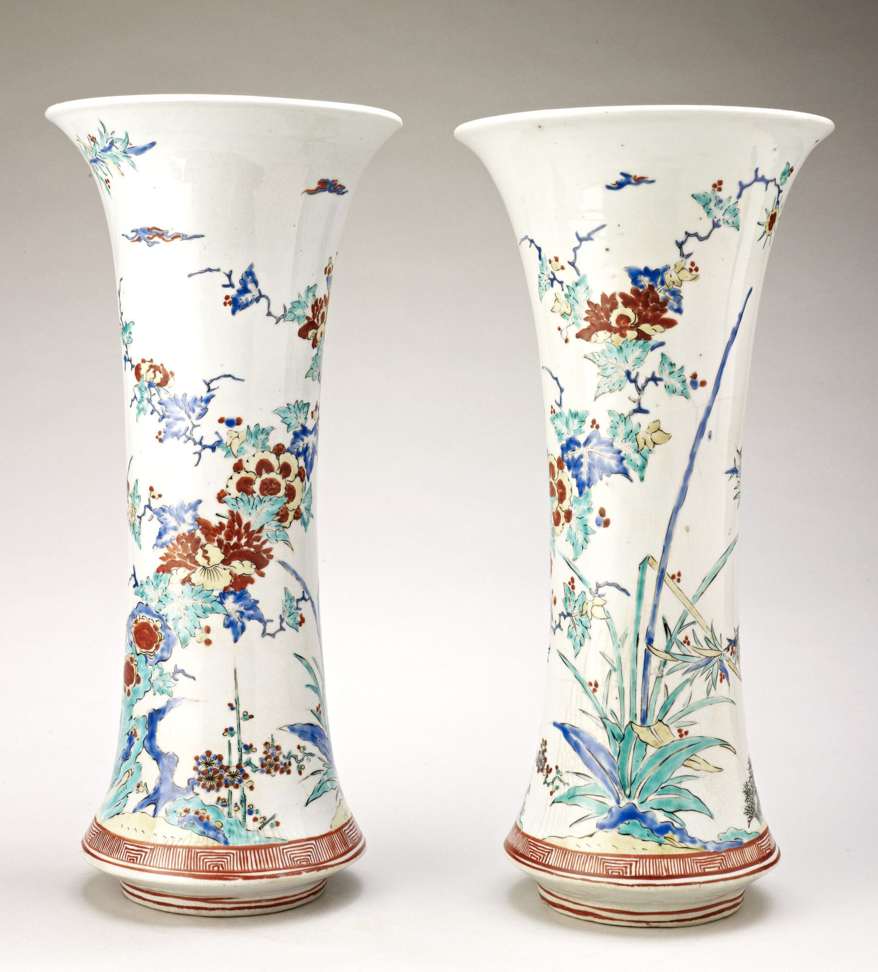 tiffany vines vase of a pair of trumpet shaped vases with flaring mouths expanding inside a pair of trumpet shaped vases with flaring mouths expanding towards base then sharply restricted to foot boldly decorated with enamels all over the glaze