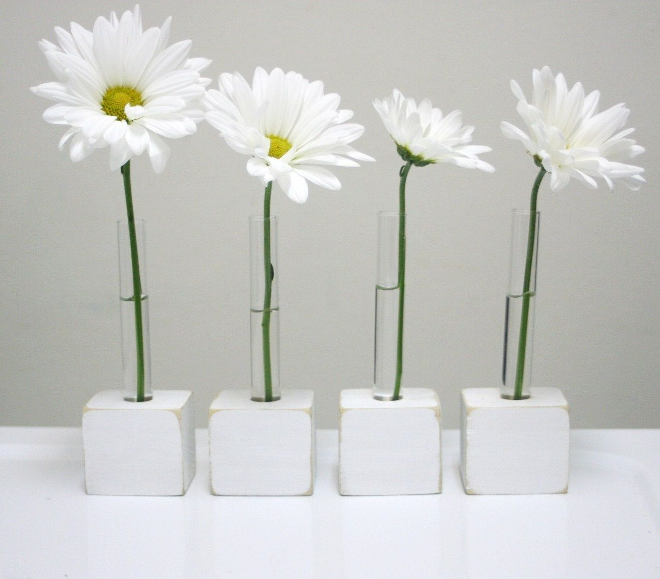 tube bud vase of gerbera daisies feel appropriately playful and mod in stem in gerbera daisies feel appropriately playful and mod in stem supporting test tube vases 14 for a set of 4