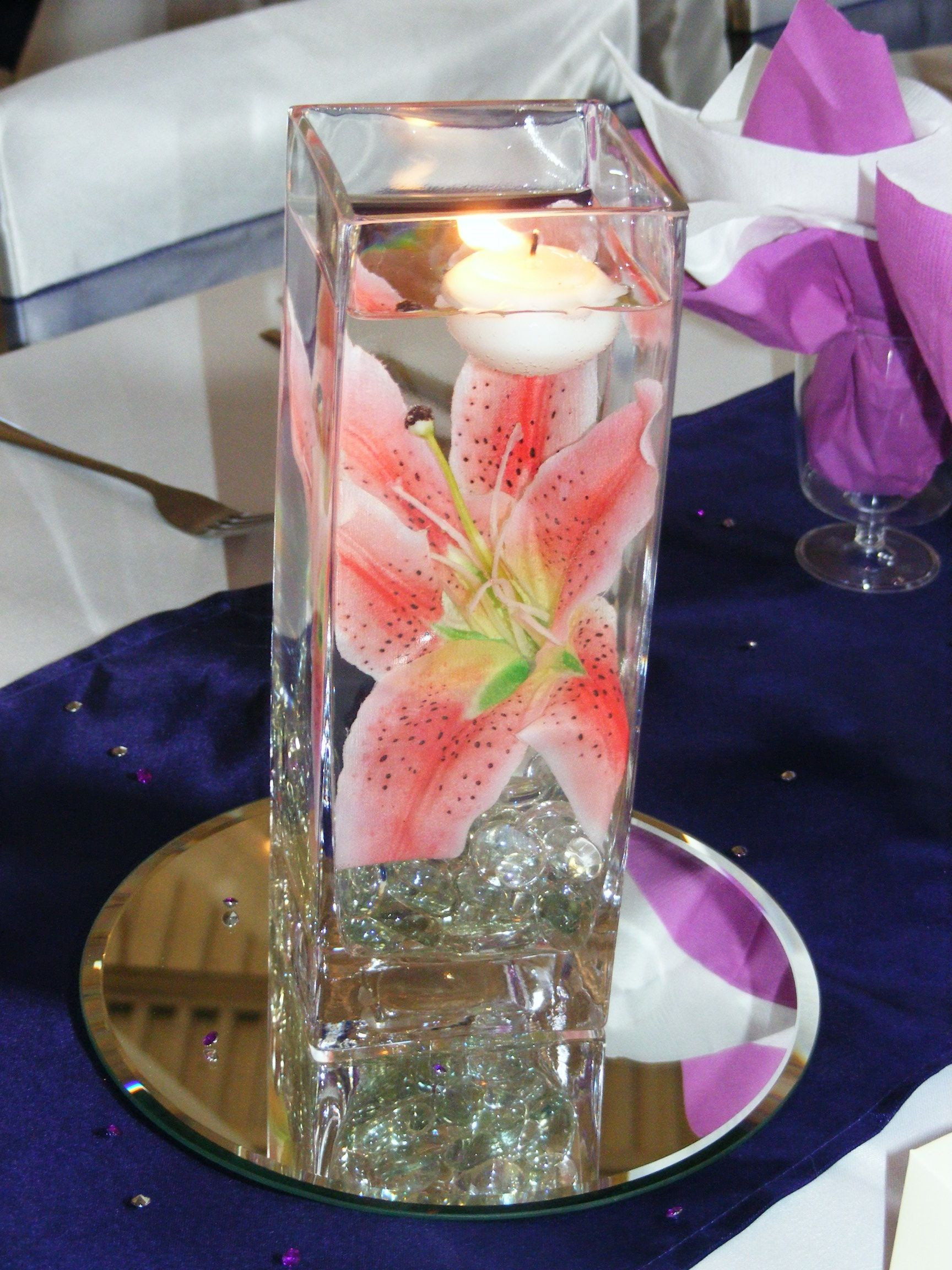 wedding centerpieces vases floating candles of star gazer lily in square vase with floating candle flowers with regard to star gazer lily in square vase with floating candle