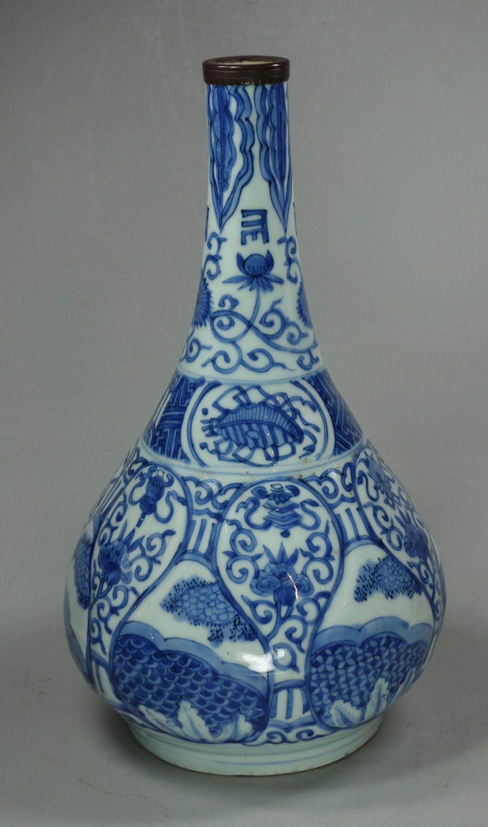White Ceramic Pumpkin Vase Of Chinese Blue and White Kraak Bottle Vase Wanli 1573 1610 with A Inside Chinese Blue and White Kraak Bottle Vase Wanli 1573 1610 with A Moulded Body Of Stylised Foliage Height 10 1 4in 26 Cm